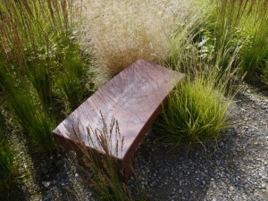 Deschampsia, sesleria and molinia setting off Jenny Holzer's sculpture at Hauser and Wirth Somerset